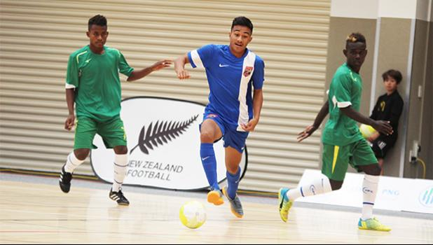 Walter Pati of American Samoa dribbles away from two Solomon Islands' opponents during a game of the OFC Youth Futsal Tournament at Bruce Pulman Arena in Auckland, New Zealand on Wednesday, October 4, 2017.  [FFAS MEDIA/Brian Vitolio]