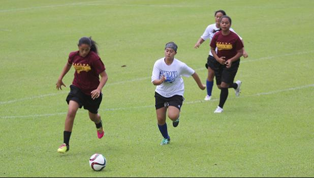 Destiny Kapisi of Tafuna (left) in action against the Samoana Sharks during an ASHSAA J-V girls' soccer game on Saturday, Feb. 24, 2018 at Pago Park Soccer Stadium.  [FFAS MEDIA/Brian Vitolio]