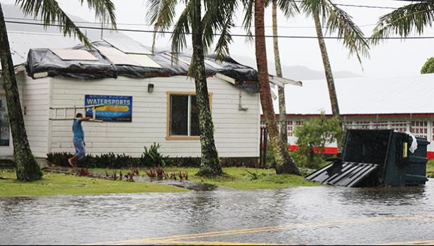 A look at the South Pacific Watersports in Utulei as workers tried to cover the blown off roof from Tropical Storm Gita this past weekend. [photo: TG]