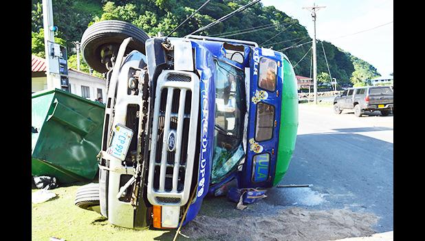 overturned bus in Aua