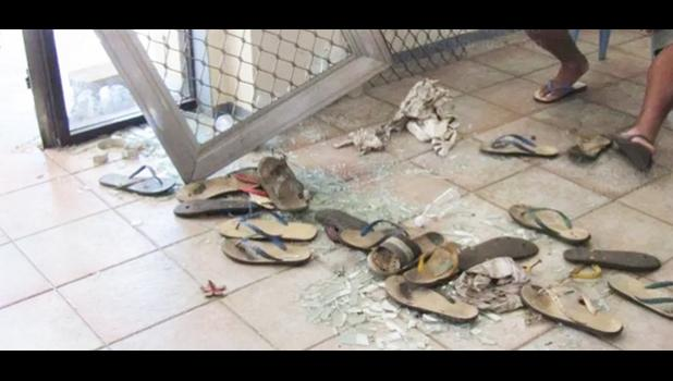 Broken glass and scattered slippers