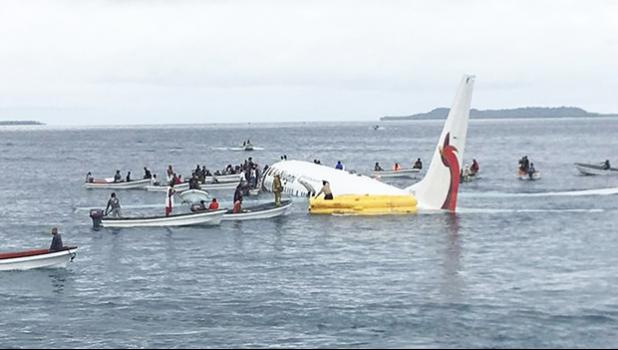 local fishing boats move in to recover the passengers and crew of Air Niugini flight