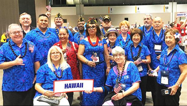 Igafo Maria Brown Va'a (middle holding US flag with red lei) along with the Hawaii Veterans of Foreign War delegation