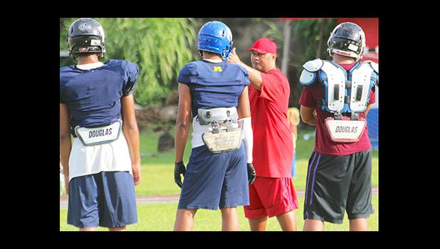 All-Star Linebacker coach Merton Hunkin of Faga'itua High School working with his backs, during practice this past Tuesday. [photo: TG]