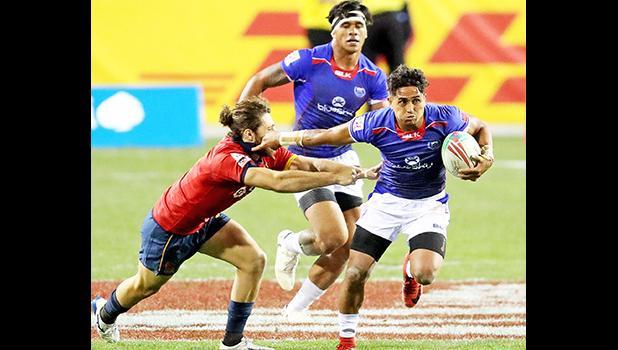 Samoa's Elisapeta Alofipo makes a break against Spain
