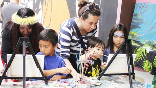 Artist Lureen Cascara helps Koa Kaeka Baptista, 9, with his painting while Michelle Florido helps her son Tristan, 3, and Corinne Ebias, 9, with their painting during the Aloha Festival at the Napa Valley Expo on Saturday. [Maria Sestet, Napa Valley Register]