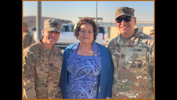 Amata with two American Samoa soldiers in the Middle East