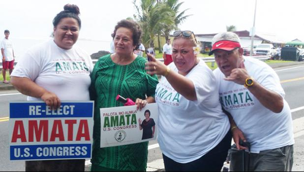Incumbent Congresswoman Aumua Amata with supporters during her campaign wave at Avau