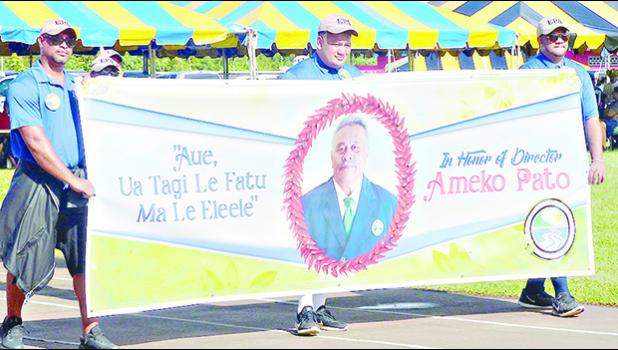 American Samoa Environmental Protection Agency employees with a banner honoring the agency's executive director Ameko Pato at last Friday's Workforce Day at Veterans Memorial Stadium.