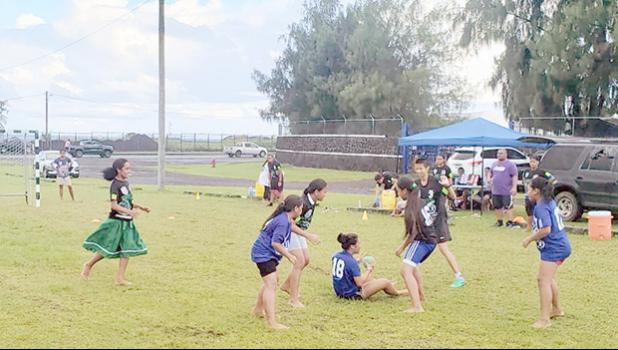 Amelie Chen of The Wolves fights for a loose ball