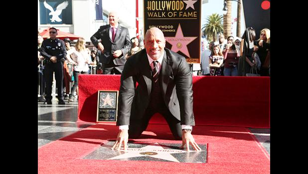 Dwayne Johnson poses for a photo at his star ceremony at the Hollywood Walk of Fame on Wednesday, Dec. 13, 2017, in Los Angeles. (Photo by Willy Sanjuan/Invision/AP)