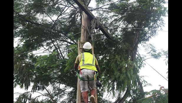 lineman climbing power pole