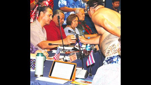 Western Pacific Regional Fishery Management Council, Taotasi Archie Soliai (left) accepting his 'ava cup, In the background (L-R) are: Lt. Governor Lemanu Peleti Mauga, Council executive director Seuta'atia Kitty M. Simonds, and Secretary of Samoan Affairs, Mauga Tasi Asuega.