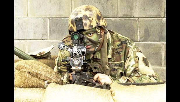 Army Reserve Soldier from the 100th Infantry Battalion on the firing line