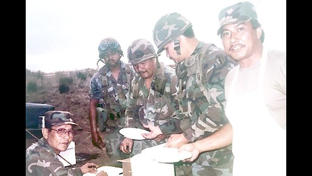 Historical photo of Army Reserve Soldiers from the 100th Infantry Battalion taking a break for a meal