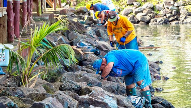 Members of the Pago Pago Seventh-Day Adventist Church picking up debris