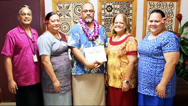 Dr. Rosevonne Pato (2nd left) and ASCC administrators celebrate with Dr. Kamo Koloi (center)