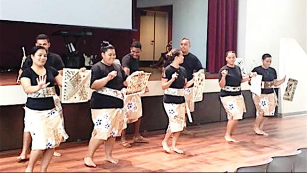 ASCC cultural arts students dancing and displaying tapa