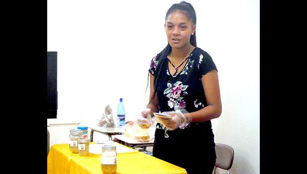 "Pauline Filisi prepares to give samples of original product ""Betty's Banana Jam"""
