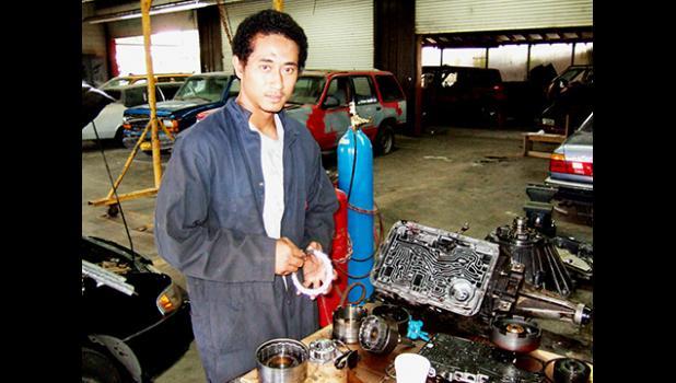 Young man in ASCC-TTD auto mechanic garage