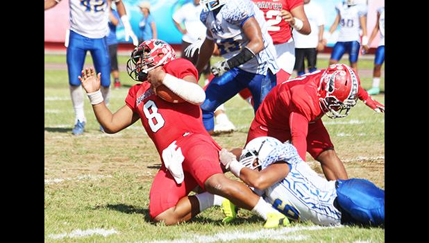 Vito Kitiona of the Vikings is sacked in the backfield by a Samoana defender, during the second quarter of their playoff game this past Saturday at the Veterans Memorial Stadium. The Vikings lost to the Sharks 19-16. [photo: TG]