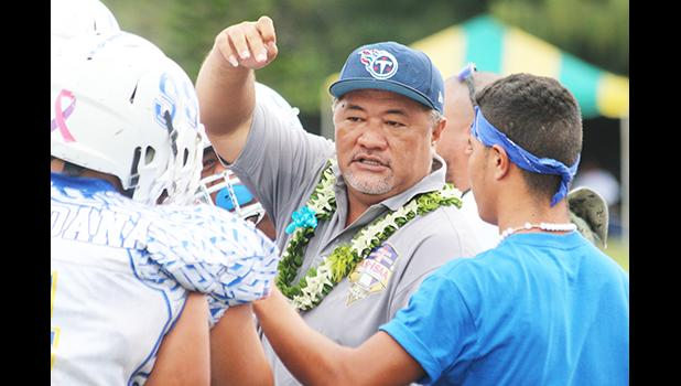 Samoana High School principal Tupa'i Rod Atafua encouraging the Sharks in a time-out during the championship game against the Warriors last Saturday morning, where the Blue Empire claimed this year's title with a narrow 7-6 win. [photo: TG]