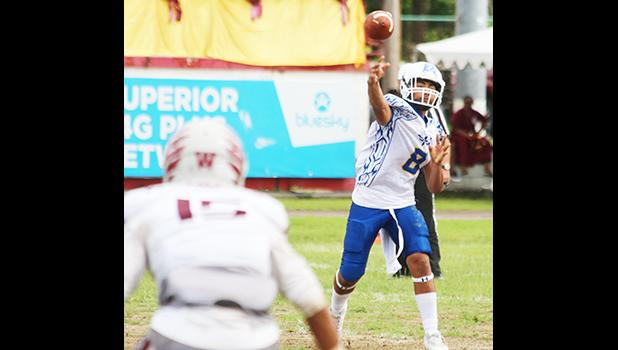 Anthony Feala of the Sharks firing a receiver screen pass out to Zephaniah Pati, during the third quarter of their varsity championship game against the Warriors. Feala and the Sharks claimed this year's ASHSAA title after a 7-6 win over Tafuna last Saturday morning.  [photo: TG]