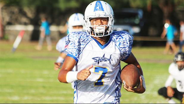 Samoana Sharks quarterback, Jr. Tanielu running in his second eighty plus yard quarterback keep for a touchdown. Tanielu led the Sharks with 3 touchdown receptions, all from quarterback keeps, in their 32- 8 victory over the Wildcats, last Friday evening.  [photo; TG]