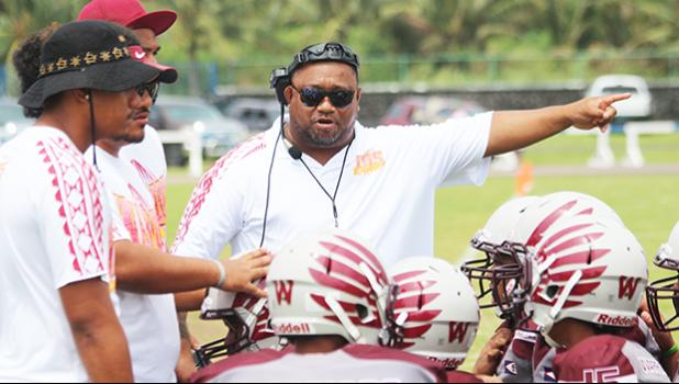 Tafuna Warriors head coach pointing towards the Vikings sidelines and encouraging his Warriors during a time out of a JV game against the Vikings last Saturday morning, where Tafuna smashed Faga'itua in a 24-0 shut out JV victory.  [photo: TG]