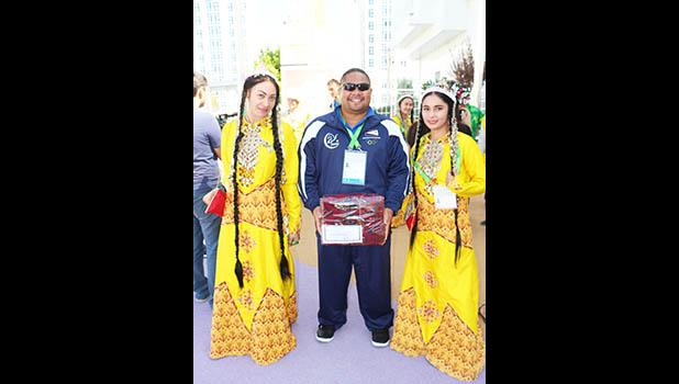 American Samoa Wrestler Zena Iese with two Turkmenistan Dancers after welcoming ceremony. (Photo:ASNOC\TCA)