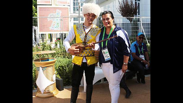 Terry Custodio Auva'a, Team American Samoa's Press Attache for the 2017 -  5th Asian Indoor and Martial Arts Games, takes time out for a photograph with a Turkmenistan dancer and dutar player during the First Official Team Welcoming Ceremony .   (Photo:ASNOC\TCA)
