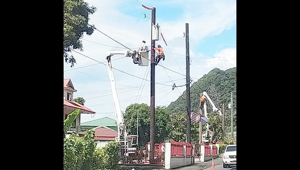 ASPA workers in a bucket truck installing streetlights.
