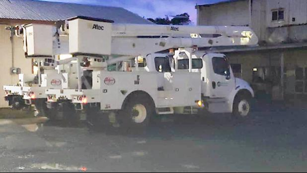 Two newly acquired bucket-trucks at the ASPA compound