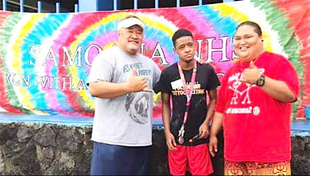 Samoana HS principal Rod Atafua with Special Education teacher Mafutaga Taase and SPED student DeAndre Chen