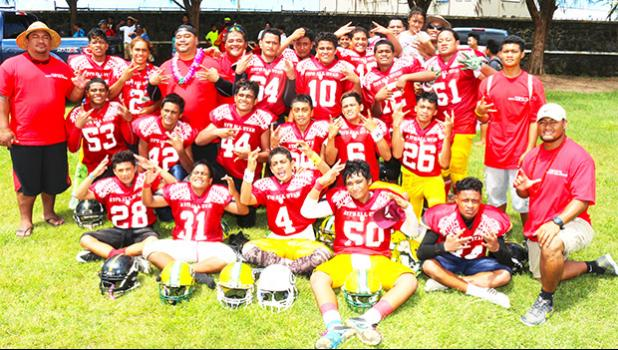The AYFS Red All Star Team led by Head Coach Kirifi Ofagalilo (bottom right) posing for a team photo after defeating the AYFS Blue All Star team in a stunning 14-8 comeback victory last Saturday at the Veterans Memorial Stadium. (See tomorrow's Samoa News issue for the Red and Blue All-Star Game story and more photos) [photo: TG]