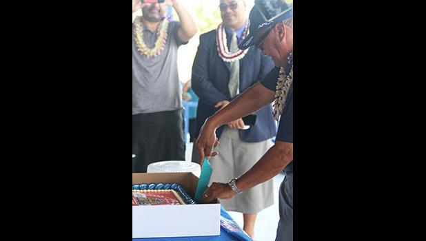 Stadium director Tole'afoa Henry Tavake cutting the cake