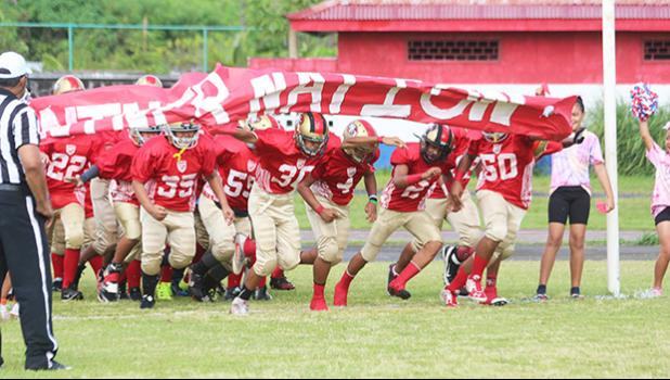 The AYFS 49ers 'Niner Nation' running out to the field for the first time this season to face the AYFS Bears during the season opener last Saturday morning at the Veterans Memorial Stadium. [photo: TG]