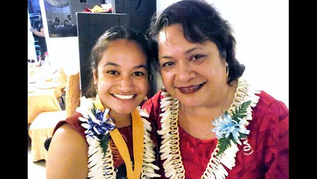 ASCC Admissions Officer Elizabeth S. Leuma congratulates spring 2019 graduate Zemirah Pati.