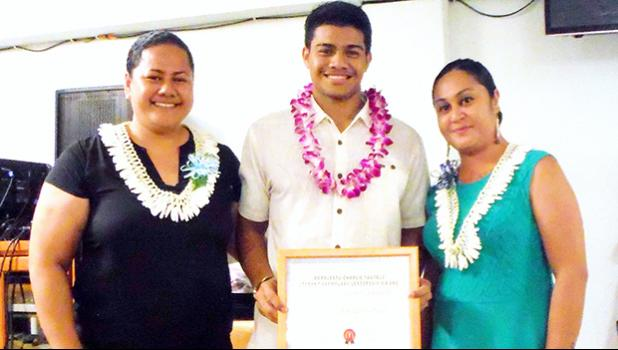 Ionatana Tuitasi received the McDonalds Scholarship from McDonalds American Samoa representatives Delores Tautolo and Katie Afuamua.