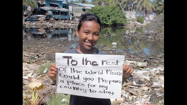 A child in Tuvalu asks the rest of the world to please find a place for her country.