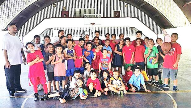 Pictured are some of the kids who came out on Saturday, with Coach Michael Pereira (standing far left)  [photo: Mark Espiritu]