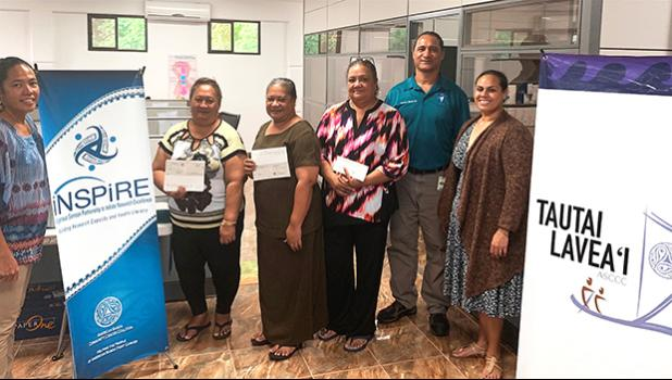 (l-r) ASCCC treasurer Christinna Lutu-Sanchez, Akenese Maifea, Faaeteete Sio, Meleseini Siufanua, ASCCC chairman Taotasi Archie Soliai, and board member Dr. Jueta McCutchan. (Not pictured is Lumana'i Maifea).