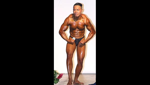 Winner of the Over 70kg Category, Aunese 'Ounce' Tauinaola during his Most Muscular pose. [photo: TG]