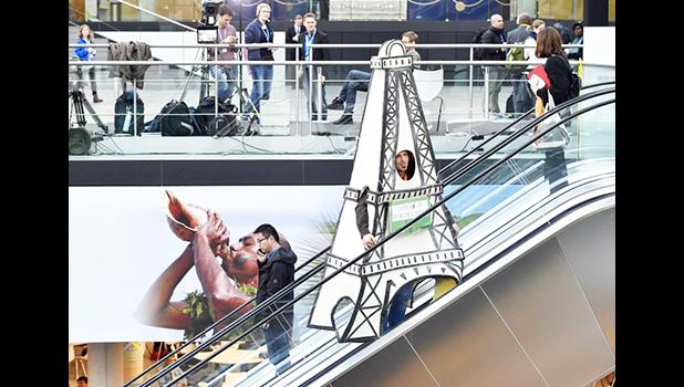 Delegates take moving stairs in the convention center during the COP 23 Fiji UN Climate Change Conference in Bonn, Germany, Friday, Nov. 17, 2017. (AP Photo/Martin Meissner)