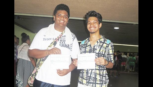 Two participants of the Summer Youth Employment Program smiling as they receive their first paychecks which were disbursed yesterday afternoon inside the EOB atrium. [photo: Sabrina Sinapati]