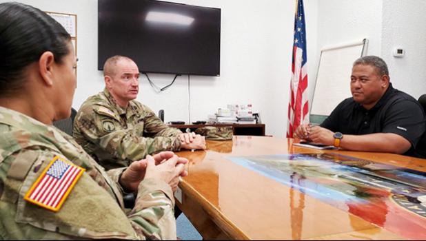 rig. Gen. Timothy Connelly and Command Sgt. Maj. Jessie Baird with Timothy Faumuina