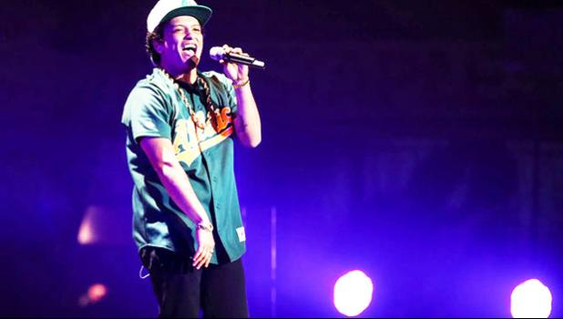 In this Dec. 2, 2016 file photo, Bruno Mars performs at the 2016 Jingle Ball at Staples Center, in Los Angeles. More than 300,000 visitors are expected to descend on Las Vegas for an extravagant New Year's Eve celebration. Nightclubs are pulling out all the stops with performances from DJ Calvin Harris, rappers T-Pain and Kendrick Lamar and artists Drake and Bruno Mars. (Photo by Chris Pizzello/Invision/AP, File)