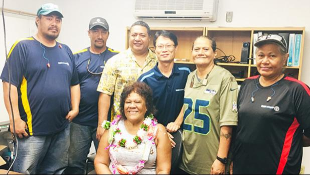 Can plant employees bid farewell to longtime employee Tapaau Fleming (seated)
