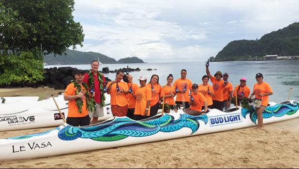 A representative of SoPac Distributors (Bud Light), who sponsored one of the canoes, for the Le Vasa Club celebrating the blessing of the new outrigger canoes on Tuesday afternoon at the Sadie's by the Sea beach in Utulei. [photo: Ese Malala]