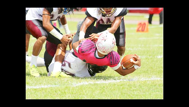 Raemos Fano's leaping touchdown in the second half of their championship game against the Warriors last Saturday – after leading the Vike's inside the Warriors red zone, Fano muscled his way to scoring this one — as he was brought down by Warriors So'oso'o Letuli, Fano was still able to leap the football pass the goal line for his first touchdown of the game.  [photo: TG]
